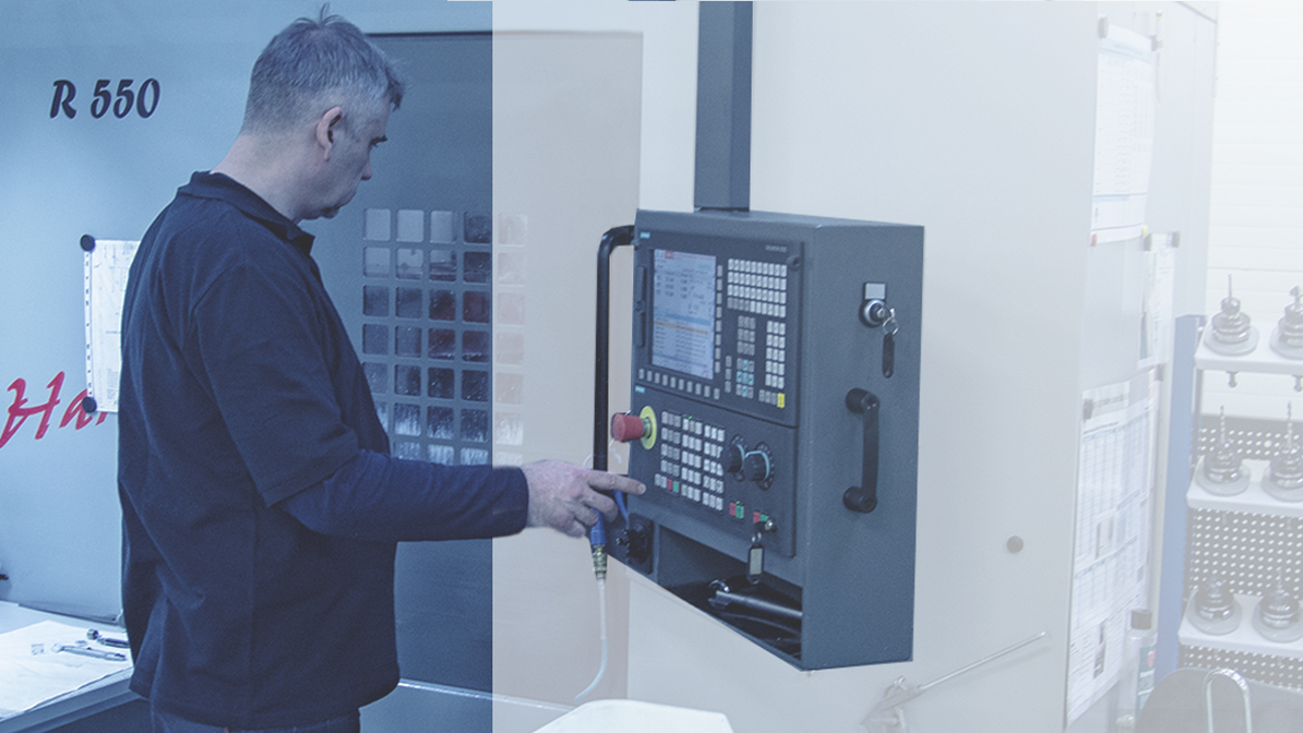 Person by the machine which carves the chassis